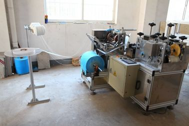 China PlastIc Shoe Cover Making Machine 3 KW ALT-PE400 60 Pcs/Min With Nonwoven Strip distributor